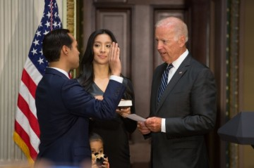 Vice President Joe Biden ceremonially swears in Julian Castro as Secretary of Housing and Urban Development, in the Indian Treaty Room of the Eisenhower Executive Office Building at the White House, August 18, 2014. Also pictured are Secretary Castro's wife Erica, and daughter Carina.